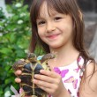 Smiling little girl holding a russian tortoise. Loving nature concept — Stock Photo #51815343