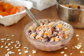 Healthy vegan oatmeal with sesame milk, fruits and seeds — Stock Photo