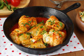 Stuffed cabbage rolls with rice and mushrooms in tomato sauce. Dolma, sarma, or golubtsy - traditional dish of many countries — Stock Photo