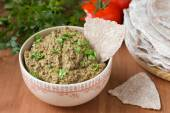 Baba ghanoush - dish of Arabic cuisine made of eggplants and tahina — Stock Photo
