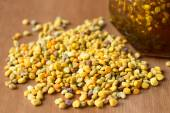 Bee pollen and honey — Stock Photo
