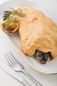 Whole fish prepared in crust with citron — Stock Photo