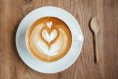 Top view cup of coffee latte with spoon — Stock Photo