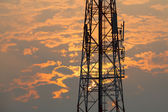 Communication tower during sunset — Stock Photo