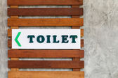 Toilet sign on wood — Stock Photo