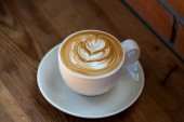 Cup of latte coffee — Stock Photo
