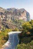 Road running under monasteries build on sandstone ridge — Stock Photo