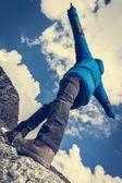 Hiker catching balance on mountain ridge — ストック写真