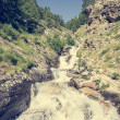 Mountain clean water flowing down a stream. — Stock Photo #64924565