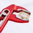 Italian Euro coin squezzed with pliers. — Stock Photo #77214587