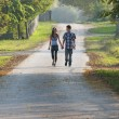 Teen girl and boy walking and looking each other — Stock Photo #58227533