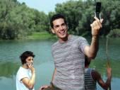 Guy taking photo — Stock Photo