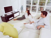 Watching television together — Stock Photo