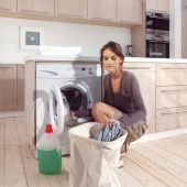 Girl in the laundry room asm — Stock Photo