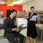 Workers using copy machine iol — Stock Photo