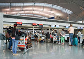 Asian travellers at arrival terminal in Tan Son Nhat — Stock Photo