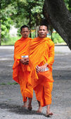 Asian young monks walking morning alms — Стоковое фото