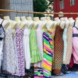 Woman dresses hanging on display at a flea market — Stock Photo #74728435