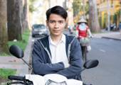 Asian man with a motorcycle on the street — Stock Photo