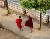 Burmese monks walking on street in Yangon — Stock Photo