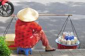 Street vendor selling coconuts in Saigon — Stock Photo