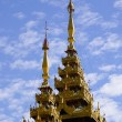 Top of golden stupa at Shwedagon pagoda — Stock Photo #76262895