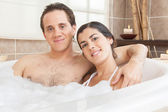 Couple smiling in the tub — Stock Photo