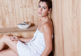 Woman enjoying the sauna — Stock Photo