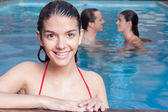 Woman smiling in the pool — Stock Photo
