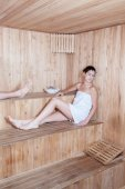 Relaxed woman in sauna — Stock Photo