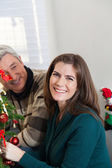 Happy couple in christmas — Stock Photo