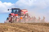 Tractor harrowing the field — Stock Photo