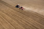 Aerial view of the tractor harrowing the field — Stock Photo