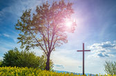 Sunset over the cross — Stock Photo