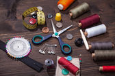 Vintage set of threads, scissors and buttons — Stock Photo