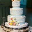 Three tiered wedding cake with candy roses — Stock Photo #62900455