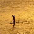Silhouette of man paddleboarding — Stock Photo #62905285