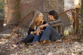 Beautiful couple talking in leaves — Stok fotoğraf