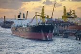 Oil tankers unloading — Stock Photo