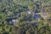 Aerial neighborhood with pond — Stock Photo