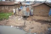 Children and filthy water, Kibera Kenya — Stock Photo