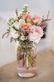 Mason jar of roses — Stock Photo