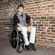 Young man in wheelchair — Stock Photo #63419373