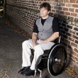 Young determined man in wheelchair — Stock Photo #63419389