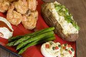 Shrimp, asparagus, and potatoes — Stock Photo
