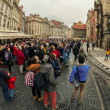 Tourists watch astronomical clock in Prague — Stock Photo #52017665