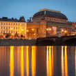 National Theater in Prague during the evening viewed from Vltava river — Stock Photo #54705515