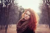 Beautiful redhead  girl outdoor — Stock Photo