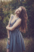 Beautiful woman  blu dress outdoor in field — Stock Photo