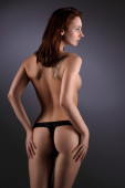 Sexy busty girl showing her pretty backside — Stock Photo